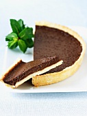 Slice of Chocolate Tart with Half a Chocolate Tart
