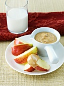 Apple Slices with Peanut Butter Dip; Glass of Milk