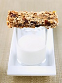 Homemade Granola Bar on Glass of Milk