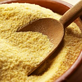 Bowl of Cornmeal with Wooden Scoop