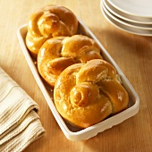 Three Challah Rolls in Ceramic Basket
