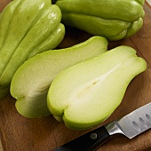 Halved and Whole Chayote Squash