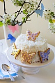 Coconut Cake Decorated with Butterfly Cookies