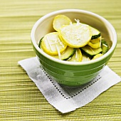 Sliced Yellow Squash and Zucchini with Shredded Parmesan Cheese in a Small Bowl
