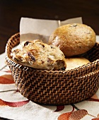 Variety of Rolls in a Basket; Olive, Pecan Raisin and Sourdough