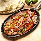Beef Fajita Fillings in Skillet; Tortillas