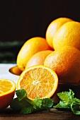 Halved Naval Orange with Bowl of Naval Oranges