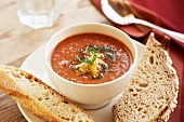 Bowl of Tomato Vegetable Soup with Bread
