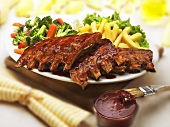 Barbecue Ribs with Fries and Vegetables; Barbecue Sauce