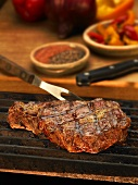 Steak on the Grill with Carving Fork
