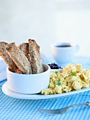 Scrambled Eggs with Toast Strips and Jam; Coffee