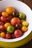 Various Heirloom Tomatoes in a White Bowl