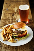 Australian Burger with Fried Egg and Pineapple; Fries and Beer