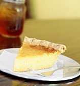 Slice of Lemon Chess Pie on a White Plate with Fork