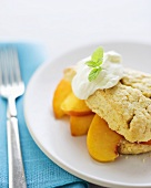 Peach Shortcake with Whipped Cream and Mint Garnish