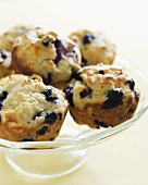 Homemade Blueberry Muffins on a Glass Pedestal Dish