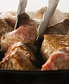 Cooking Beef Strips; Tongs
