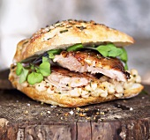 Roasted Pork Sandwich with White Beans and Greens on Bun