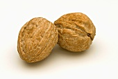 Two unshelled walnuts