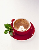 Cocoa In Red Cup with Marshmallows and Holly Sprig