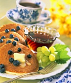 Pancakes with Fresh Blueberries, Maple Syrup and Grapes; Coffee