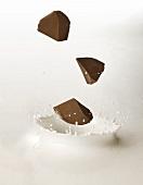 Chocolate Chunks Splashing into Milk