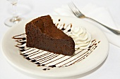 Slice of Flourless Chocolate Cake; Whipped Cream