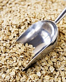 Organic Rolled Oats with a Metal Scoop