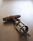 Antique Corkscrew on Wood