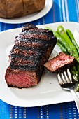 Grilled New York strip steak (medium rare) with asparagus