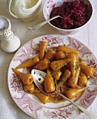 Plate of Roast Baby Carrots with Serving Spoon