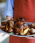 Carrying a Platter with Whole Honey Grilled Chicken with Pears