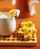 Papaya Chunks on Skewers with Gingered Cream Cheese Fondue