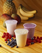 Three Assorted Fruit Smoothies in Plastic Cups