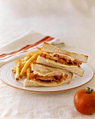 Bacon, Tomato and Cheese Sandwich on White Bread with Fries