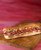 Reuben Submarine Sandwich on Cutting Board