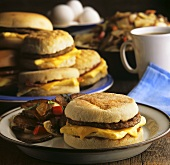 Egg and Sausage Breakfast Sandwich; Many Sandwiches on a Plate; Coffee