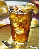Glass of Iced Tea with Ice and Lemon Garnish