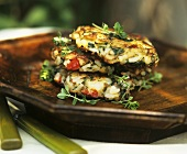 Three Herbed Potato Pancakes in a Wooden Dish
