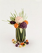 Vegetables Carved into Flowers in a Vase; White Background