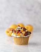 Cupcake Topped with Dried Apricots, Cranberry and Walnuts