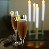 Two Glasses of Champagne with Lemon Twists; Candles