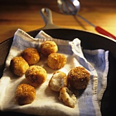 Hush Puppies on a Dish Cloth in Skillet