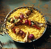 Grilled Vegetable Kabobs on a Large Bowl of Couscous