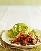 Sliced Grilled Pork Loin with Pumpkin Seeds; Side Salad