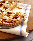 Raspberry Peach Pie with Almonds and Lattice Crust; Slice Removed