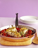 Pan of Sea Bass with Tomato and Beans; Wooden Serving Spoon