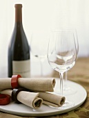 Linen Napkins in Napkin Rings with Empty Wine Glasses