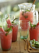 Watermelon Coolers in Glasses and Pitcher on Wooden Table