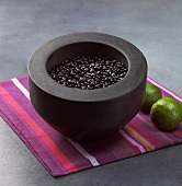 Black beans in a stone mortar